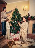 Family decorating Christmas tree Royalty Free Stock Image