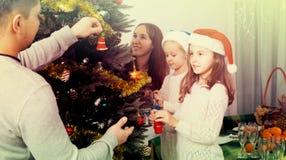 Family decorating Christmas tree at home Royalty Free Stock Photos