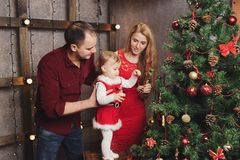 Family decorating christmas tree at home Royalty Free Stock Photos