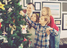 Family decorating Christmas tree at home. Young cheerful  family decorating Christmas tree at home Stock Photos