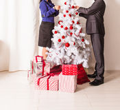 Family decorating a Christmas tree  in the living Royalty Free Stock Images