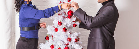Family decorating a Christmas tree  in the living Royalty Free Stock Photo