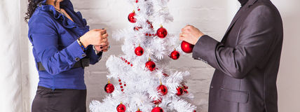 Family decorating a Christmas tree  in the living. Room Stock Photo