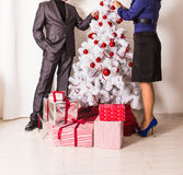 Family decorating a Christmas tree  in the living. Room Stock Images