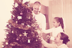Family decorating Christmas tree Royalty Free Stock Images