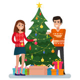 Family decorating christmas tree. Royalty Free Stock Images