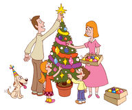 Family decorating Christmas tree together Royalty Free Stock Images