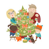 Family decorating a Christmas tree Stock Images