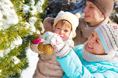 Family decorating fir tree Royalty Free Stock Image