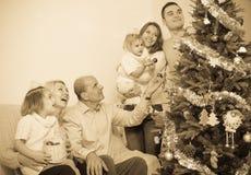 Family decorating New Year tree Stock Photos