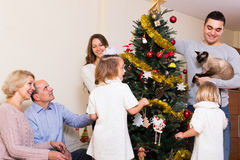 Family decorating New Year tree Royalty Free Stock Photos