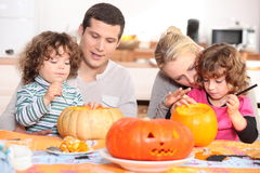 Family decorating pumpkins Stock Photo