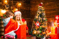 Family Decorating Service. Young sister with a little boy are helping at Christmas Lights Installation. royalty free stock photos
