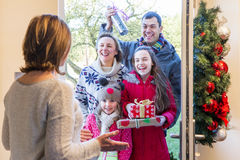 Family delivering presents at Christmas. Time. They all look happy and ready to celebrate stock images