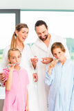 Family at dental care routine in bathroom Royalty Free Stock Photos