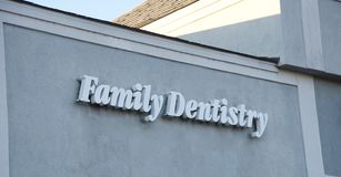 Dentistry Sign. A Family Dentistry sign on an office building that caters to families royalty free stock image