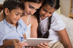 Family with digital tablet Stock Photo