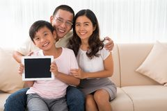 Family with digital tablet Stock Photos
