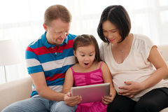 Family with digital tablet Stock Image