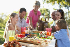 Family Dining Al Fresco. A Family Dining Al Fresco royalty free stock photography