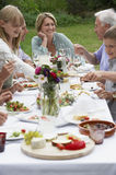 Family Dining In Garden Royalty Free Stock Image