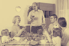 Family at the dining table Royalty Free Stock Image