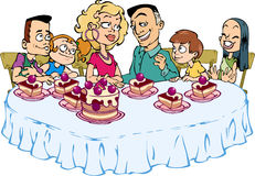 Family dinner. A happy family of six people sitting at the table and eat cake Royalty Free Stock Photography