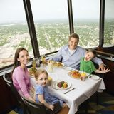 Family dinner. Caucasian family having dinner together at Tower of Americas restaurant in San Antonio, Texas stock photography