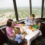 Family dinner. Caucasian family having dinner together at Tower of Americas restaurant in San Antonio, Texas Royalty Free Stock Image