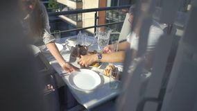 Family dinner on the balcony of the apartment. In summer stock footage