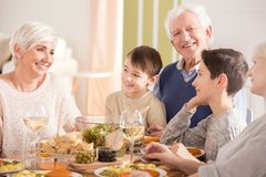 Family during dinner. Happy family talking and laughing during dinner royalty free stock photos