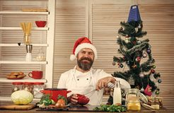 Family dinner and new year recipe. New year cuisine, menu and food. Christmas cookies at man cook in kitchen. Chef man in santa claus hat cooking. Thanksgiving royalty free stock photo