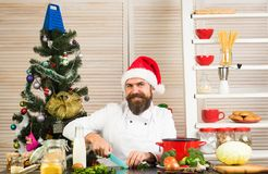 Family dinner and new year recipe. New year cuisine, menu and food. Thanksgiving day and Christmas. Christmas cookies at man cook in kitchen. Chef man in santa stock photography