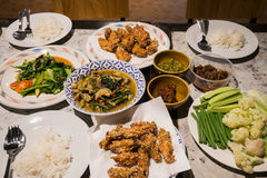 Family dinner set. Thai dinner set for family with spicy Thai food Stock Photo