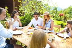 Family dinner variety of Italian dishes on wooden table in the g Royalty Free Stock Photography