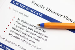 Family Disaster Plan. And ballpoint pen. Close-up Stock Photos