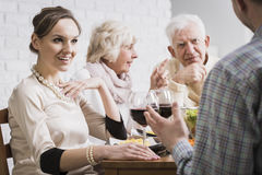 Family discussing at dinner time. Shot of a modern family discussing together at dinner time Stock Image