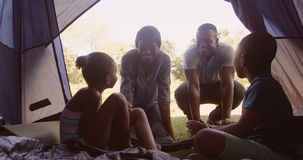 Family discussing in a tent stock video footage