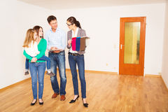 Family Discussing With Their Interior Designer Stock Photo