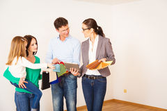 Family Discussing With Their Interior Designer Stock Photography