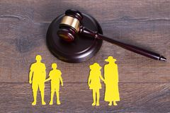 Family divorce concept. Gavel on the table and paper family representing divorce Royalty Free Stock Photos