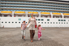 Family in dock, cruise ship on background stock photos