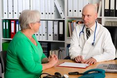 Family doctor examine a female senior Stock Image