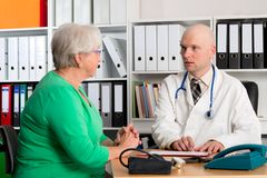 Family doctor examine a female senior Royalty Free Stock Images