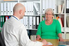 Family doctor examine a female senior Stock Images