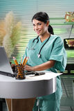Family doctor at her office Royalty Free Stock Images