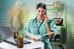 Family doctor at her office Stock Photo