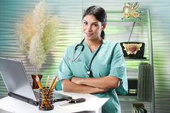 Family doctor at her office Stock Images