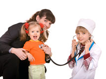 Family doctor and little girl. Royalty Free Stock Photos