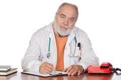 Family doctor in the oficce. On white background Royalty Free Stock Photos